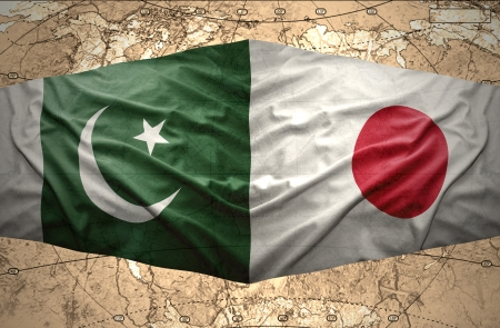 islamabad: Waving Pakistani and Japanese flags on the of the political map of the world Stock Photo