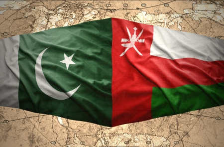 clash: Waving Pakistani and Omani flags on the of the political map of the world Stock Photo