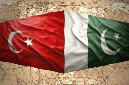 mideast: Waving Pakistani and Turkish flags on the of the political map of the world Stock Photo
