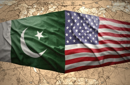 Waving Pakistani and American flags on the of the political map of the world photo