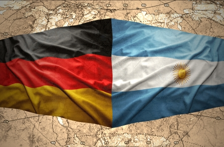 Waving Argentinean and German flags on the background of the political map of the world photo