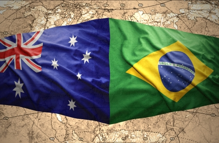 Waving Brazilian and Australian flags on the of the political map of the world photo
