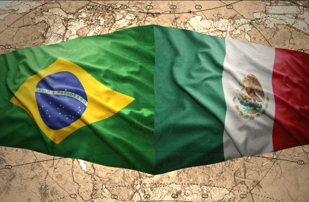 Waving Brazilian and Mexican flags on the of the political map of the world photo