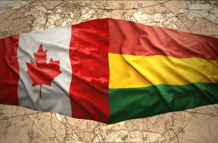 Waving Bolivian and Canadian flags on the of the political map of the world photo