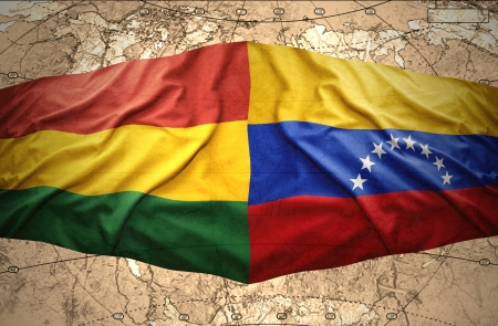 venezuelan: Waving Bolivian and  Venezuelan flags on the of the political map of the world