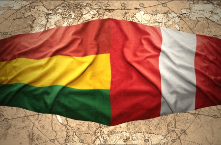 Waving Bolivian and Peruvian flags on the of the political map of the world photo