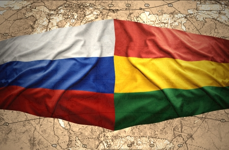 Waving Bolivian and Russian flags on the of the political map of the world photo