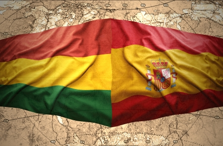 Waving Bolivian and Spanish flags on the of the political map of the world photo