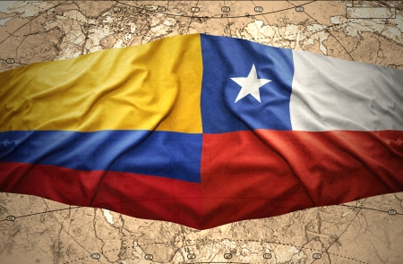 Waving Colombian and Chilean flags on the of the political map of the world photo