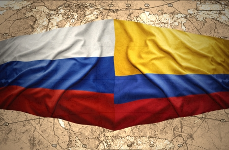 Waving Colombian and Russian flags on the of the political map of the world photo