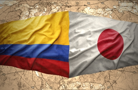 colombian: Waving Colombian and Japanese flags on the of the political map of the world