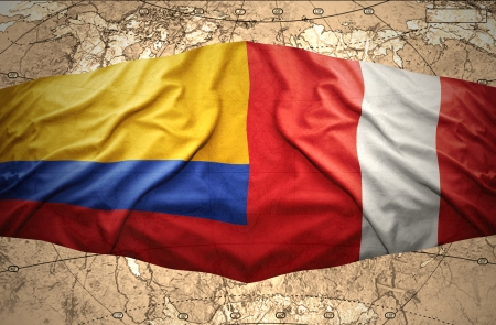Waving Colombian and Peruvian flags on the of the political map of the world photo