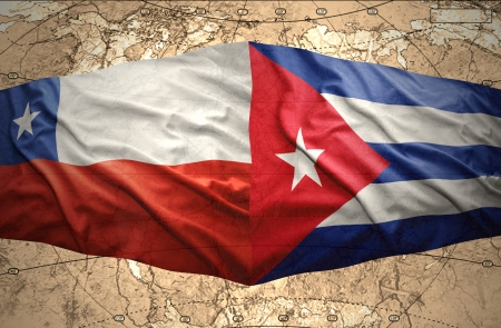 Waving Chilean and Cuban flags on the of the political map of the world photo