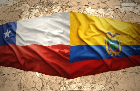 Waving Chilean and Ecuadoran flags on the of the political map of the world photo
