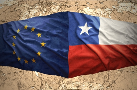 Waving Chilean and European Union flags on the of the political map of the world photo