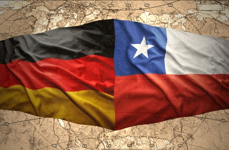 Waving Chilean and German flags on the of the political map of the world photo