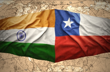 Waving Chilean and Indian flags on the of the political map of the world photo