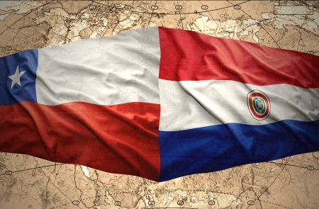 Waving Chilean and Paraguayan flags on the of the political map of the world photo