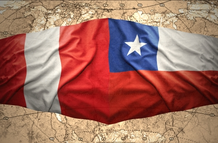 Waving Chilean and Peruvian flags on the of the political map of the world photo