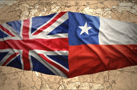 Waving Chilean and British flags on the of the political map of the world photo