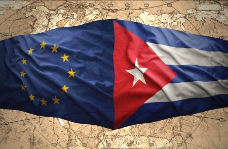 Waving Cuban and European Union flags on the of the political map of the world photo