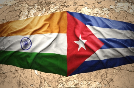 Waving Cuban and Indian flags on the of the political map of the world photo