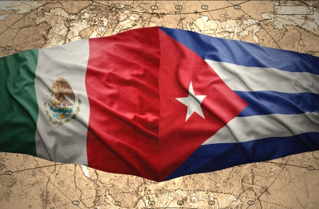 Waving Cuban and Mexican flags on the of the political map of the world photo