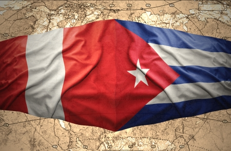 Waving Cuban and Peruvian flags on the of the political map of the world photo