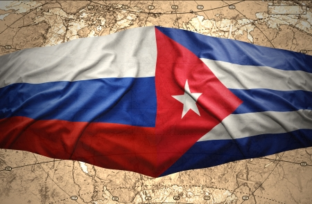 cuban flag: Waving Cuban and Russian flags on the of the political map of the world