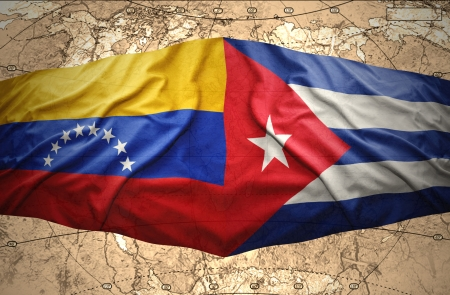 cuban flag: Waving Cuban and Venezuelan flags on the of the political map of the world