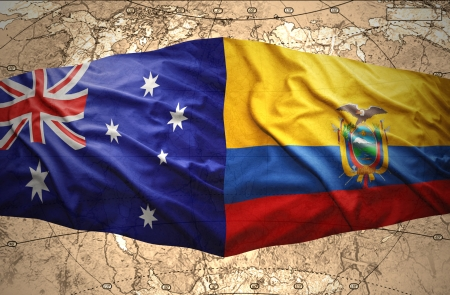 Waving Ecuadoran and Australian flags on the of the political map of the world photo