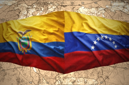 Waving Ecuadoran and Venezuelan flags on the of the political map of the world photo