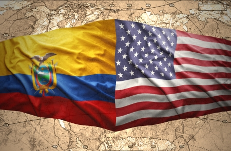 Waving Ecuadoran and American flags on the of the political map of the world photo