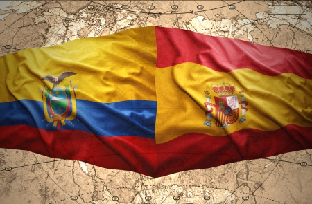 Waving Ecuadoran and Spanish flags on the of the political map of the world photo