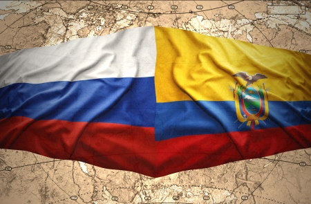 Waving Ecuadoran and Russian flags on the of the political map of the world photo