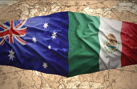 Waving Mexican and Australian flags on the of the political map of the world photo