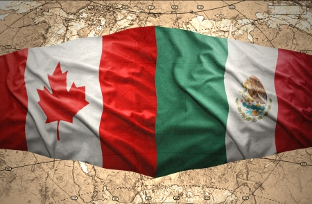 Waving Mexican and Canadian flags on the of the political map of the world photo