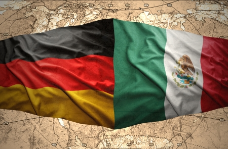 Waving Mexican and German flags on the of the political map of the world Stock Photo