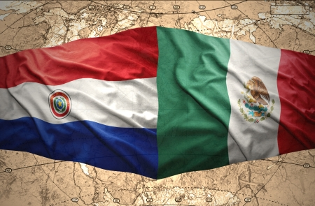 paraguayan: Waving Mexican and Paraguayan flags on the of the political map of the world Stock Photo