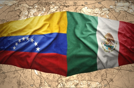 venezuelan: Waving Mexican and Venezuelan flags on the of the political map of the world