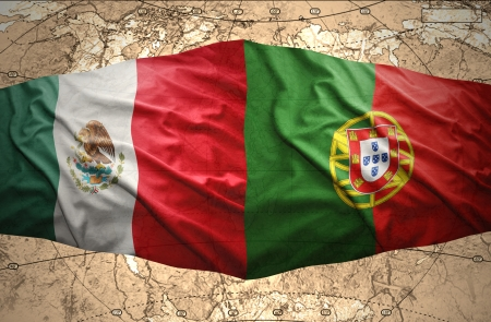 Waving Mexican and Portuguese flags on the of the political map of the world photo
