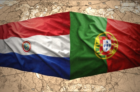 paraguayan: Waving Paraguayan and Portuguese flags on the of the political map of the world Stock Photo