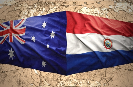 Waving Paraguayan and Australian flags on the of the political map of the world photo