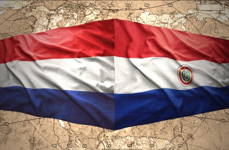 Waving Paraguayan and Dutch flags on the of the political map of the world photo