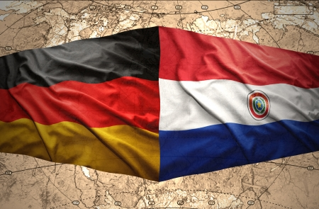paraguayan: Waving Paraguayan and German flags on the of the political map of the world Stock Photo