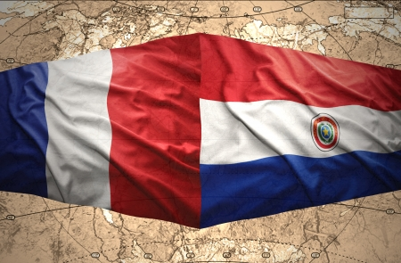 paraguayan: Waving Paraguayan and French flags on the of the political map of the world Stock Photo