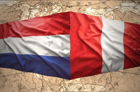 Waving Peruvian and Dutch flags on the of the political map of the world photo