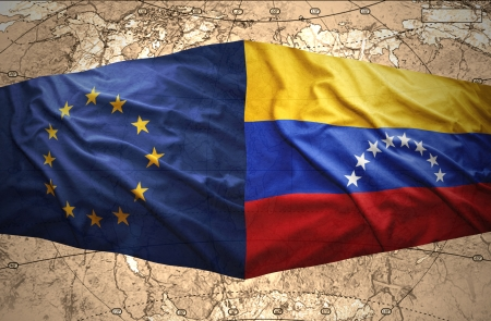 venezuelan: Waving Venezuelan and European Union flags on the of the political map of the world Stock Photo