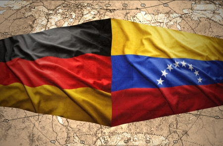 venezuelan: Waving Venezuelan and German flags on the of the political map of the world