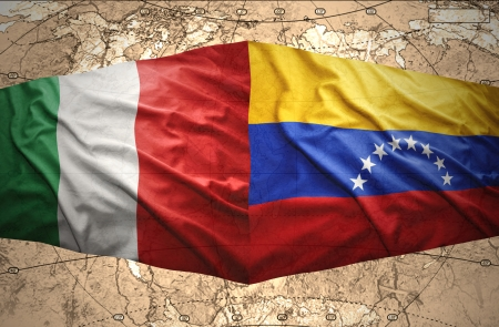 venezuelan flag: Waving Venezuelan and  Italian flags on the of the political map of the world